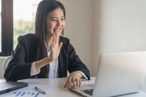 Happy young woman on an online meeting