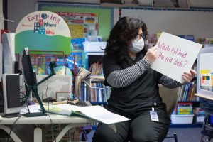A second-grade teacher uses a white board to teach both her in-class and online students at Wesley Elementary School.